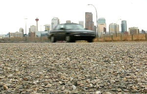 Some roads in Calgary are still gravel. City council is considering a citywide paving program for these gravel roads. Photograph by: Marianne Helm , Calgary Herald